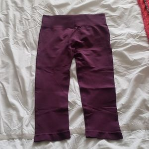 Burgundy seamless running tights. Size medium